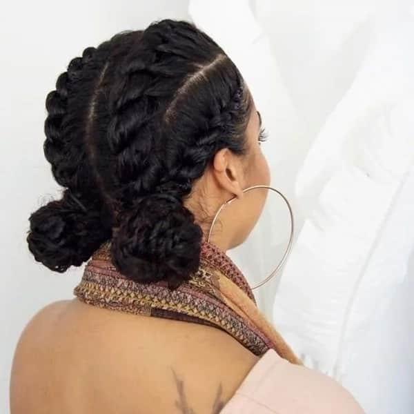 Four flat twists into two low buns