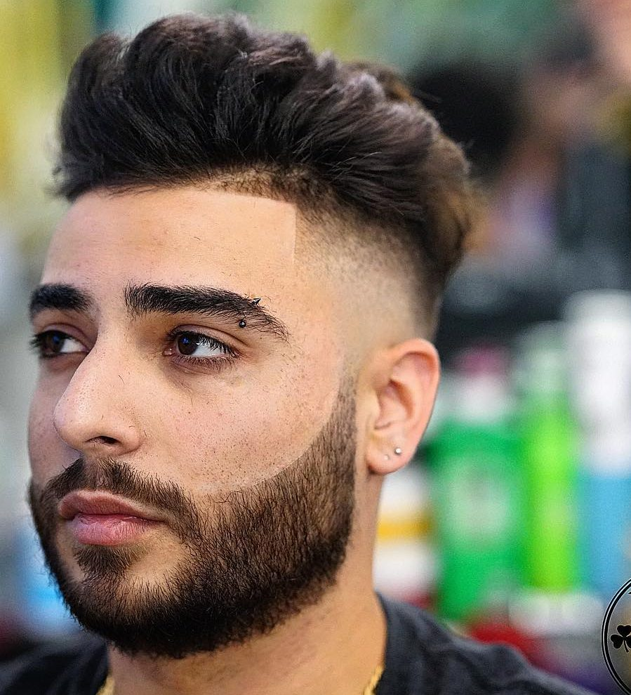 Textured pompadour hairstyle and bald fade with line up