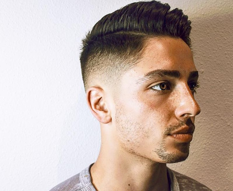 Comb over haircut with mid fade